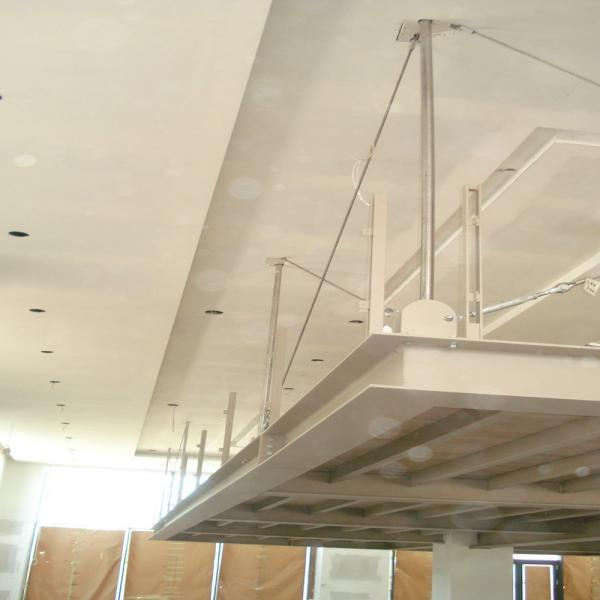 Suspended steel structure from the existing flat slab, Mexil A.E.